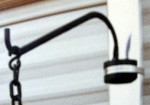 Hook on RV awning arm
